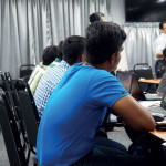 Foreign migrant workers learning computer on weekends